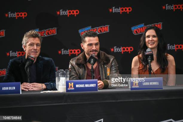 Actors Aidan Gillen Michael Malarkey and Laura Mennell speak during HISTORYs Project Blue Book NYCC Panel 2018 at the Jacob Javits Convention Center...