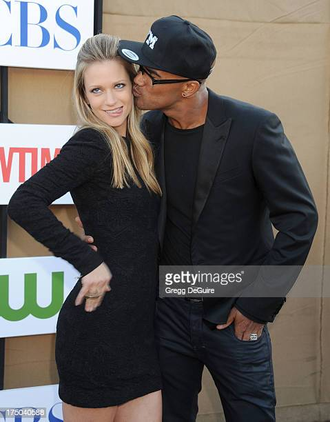 Actors AJ Cook and Shermar Moore arrive at the CBS/CW/Showtime Television Critic Association's summer press tour party at 9900 Wilshire Blvd on July...