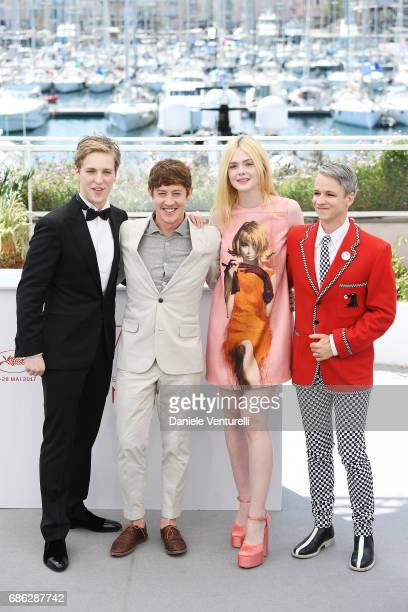 Actors AJ Lewis Alex Sharp Elle Fanning and director John Cameron Mitchell attend the 'How To Talk To Girls At Parties' photocall during the 70th...
