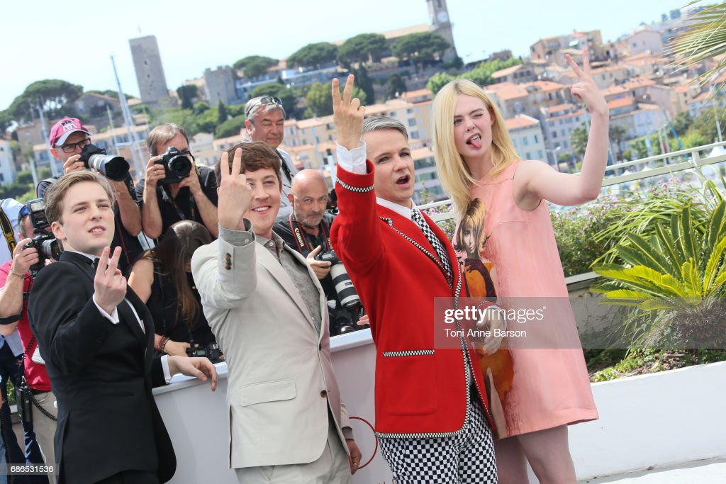 Actors AJ Lewis, Alex Sharp, Elle Fanning and director John Cameron Mitchell attend the 'How To Talk To Girls At Parties' Photocall during the 70th annual Cannes Film Festival at Palais des Festivals on May 21, 2017 in Cannes, France.