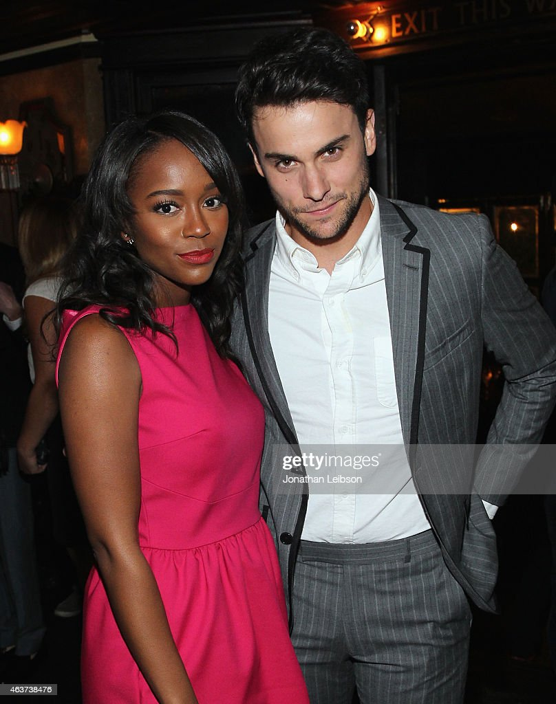 Actors Aja Naomi King (L) and Jack Falahee attend Vanity Fair and FIAT celebration of Young Hollywood, hosted by Krista Smith and James Corden, to benefit the Terrence Higgins Trust at No Vacancy on February 17, 2015 in Los Angeles, California.