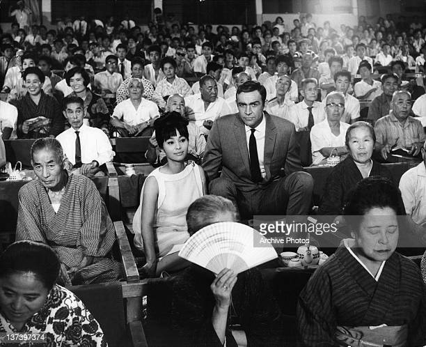 Actors Akiko Wakabayashi and Sean Connery at a Japanese sumo match in a scene from the film 'You Only Live Twice' 1967