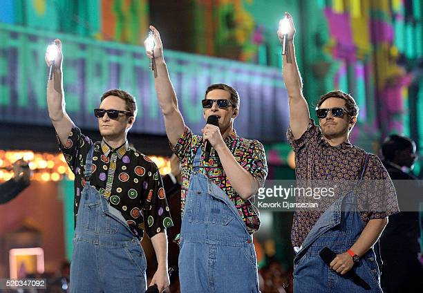 Actors Akiva Schaffer Andy Samberg and Jorma Taccone of The Lonely Island perform onstage during the 2016 MTV Movie Awards at Warner Bros Studios on...