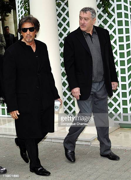 Actors Al Pacino and Robert De Niro arrive to attend a photocall for the Jon Avnet's film 'Righteous Kill' on September 15 2008 in Paris France