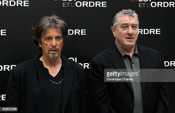 Actors Al Pacino and Robert De Niro pose during a photocall for the Jon Avnet's film 'Righteous Kill' on September 15 2008 in Paris France