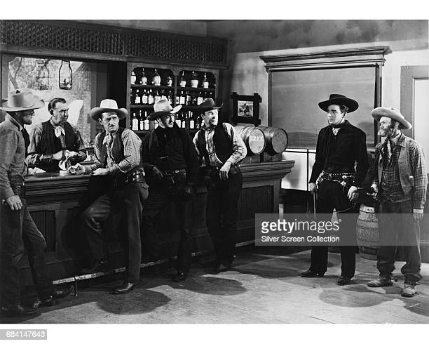 Actors Al St John as Fuzzy and Lash La Rue as Cheyenne in the western film 'Pioneer Justice' 1947 They are confronting Bill Judd and his gang