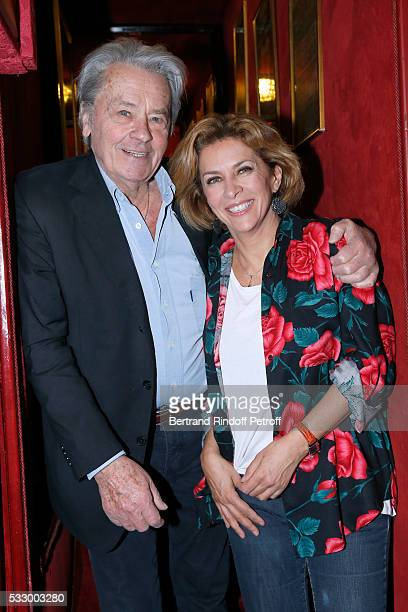 Actors Alain Delon and Corinne Touzet attend the 100th representation of the Theater piece 'Un nouveau depart' at Theatre Des Varietes on May 19 2016...