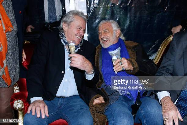 Actors Alain Delon and JeanPaul Belmondo attend 'La Grande Roue de Paris' Opening Ceremony at Place de la Condorde on the Champs Elysees on November...