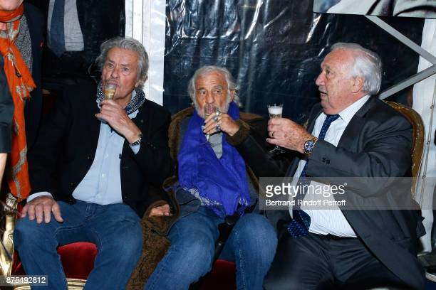 Actors Alain Delon and JeanPaul Belmondo come to see their friend Marcel Campion for 'La Grande Roue de Paris' Opening Ceremony at Place de la...