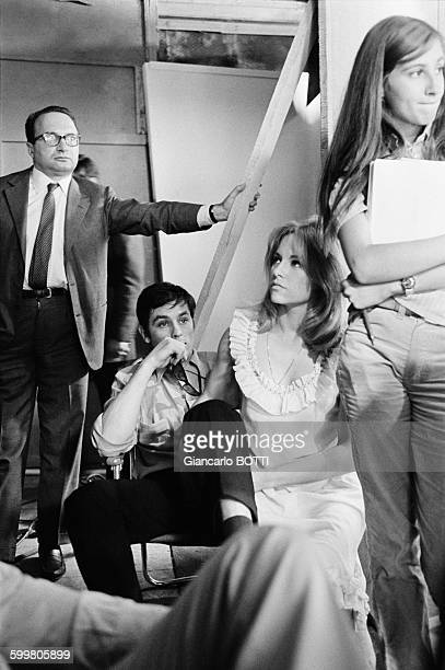 Actors Alain Delon And Nathalie Delon On The Set Of The Movie 'Le Samourai' Directed By JeanPierre Melville With Manager Georges Beaume On Left In...