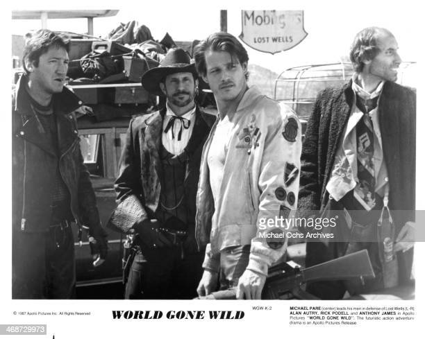 Actors Alan Autry Rick Podell Michael Pare and Anthony James on set of the movie World Gone Wild circa 1988