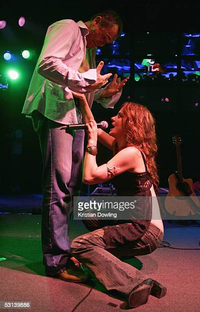 Actors Alan Fletcher and Marcella Russo perform at the Neighbours Rocks for AIDS fundraiser June 23 2005 at the Palace in Melbourne Australia