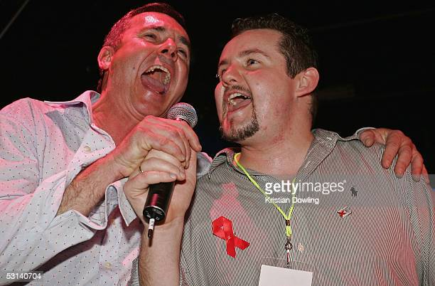 Actors Alan Fletcher and Ryan Moloney perform at the Neighbours Rocks for AIDS Fundraiser June 23 2005 at the Palace in Melbourne Australia