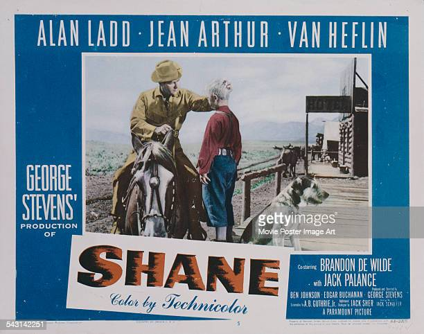 Actors Alan Ladd and Brandon De Wilde appear on a poster for the Paramount Pictures western 'Shane', 1953.