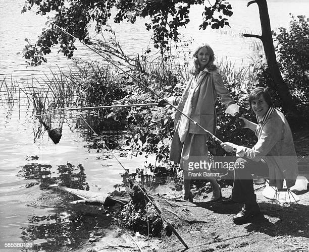 Actors Alan Price and Jill Townsend fishing on the lake during a break in filming 'Alfie Darling' at Black Park near Pinewood Studios England August...