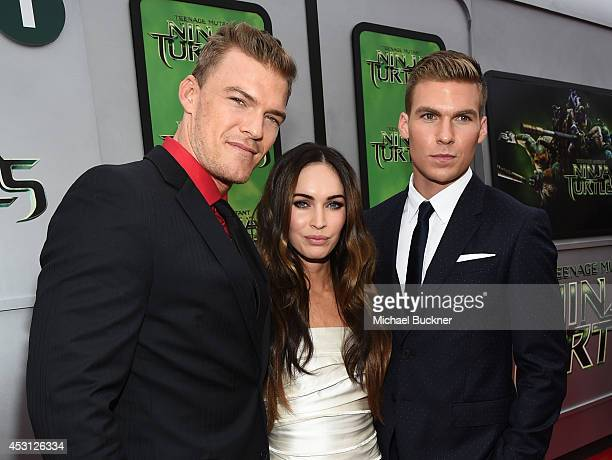 Actors Alan Ritchson Megan Fox and Pete Ploszek attend the premiere of Paramount Pictures' 'Teenage Mutant Ninja Turtles' at Regency Village Theatre...