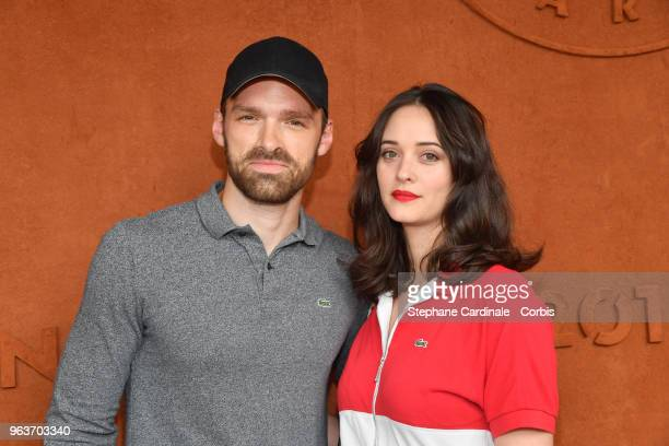 Actors Alban Lenoir and Anne Serra attend the 2018 French Open Day Four at Roland Garros on May 30 2018 in Paris France
