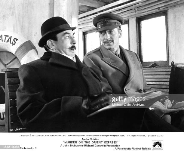 """Actors Albert Finney and Jeremy Lloyd on the set of the Paramount Pictures movie """"Murder on the Orient Express"""" in 1974."""