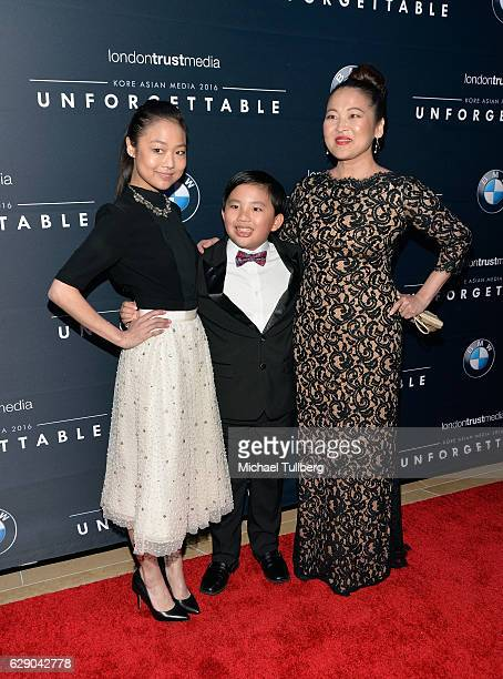 Actors Albert Tasi Krista Marie Yu and Suzy Nakamura attend the 15th Annual Unforgettable Gala at The Beverly Hilton Hotel on December 10 2016 in...