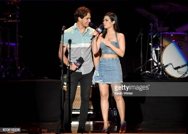 Actors Alberto Rosende and Emeraude Toubia perform onstage during MTV Fandom Fest at PETCO Park on July 21 2017 in San Diego California