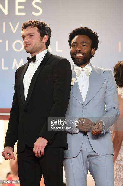 Actors Alden Ehrenreich and Donald Glover depart the screening of 'Solo A Star Wars Story' during the 71st annual Cannes Film Festival at Palais des...