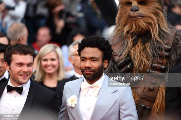 Actors Alden Ehrenreich Donald Glover and Chewbacca attend the screening of 'Solo A Star Wars Story' during the 71st annual Cannes Film Festival at...