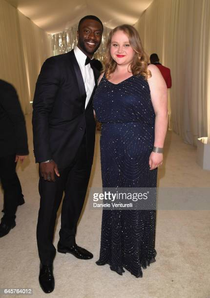 Actors Aldis Hodge and Danielle Macdonald attends Bulgari at the 25th Annual Elton John AIDS Foundation's Academy Awards Viewing Party at on February...