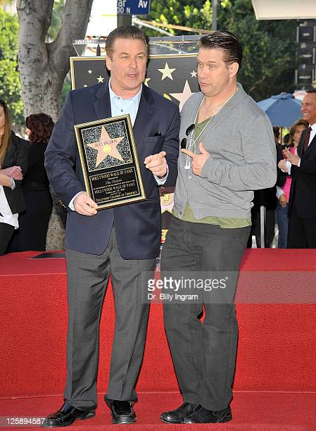 Actors Alec Baldwin and his brother Stephen Baldwin pose during Alec Baldwin's Hollywood Walk of Fame Induction Ceremony on February 14 2011 in...