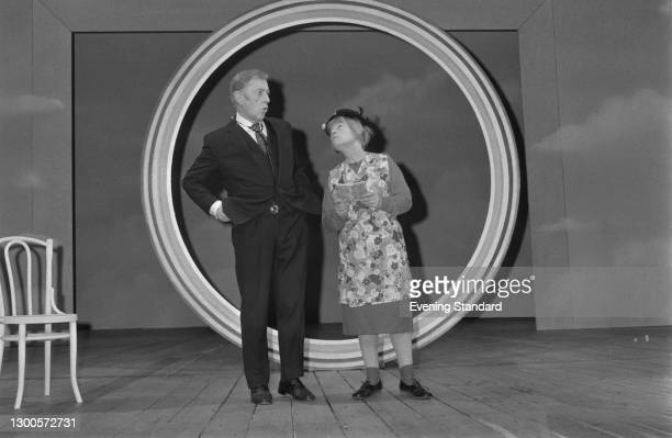 Actors Alec Guinness and Patricia Hayes star as Arthur Wicksteed and Mrs Swabb the cleaner in the stage play 'Habeas Corpus' by Alan Bennett, at the...