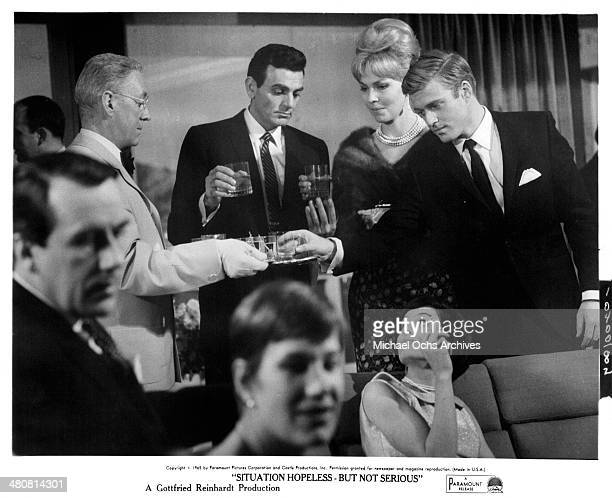 Actors Alec Guinness Mike Connors and Robert Redford on set the movie 'Situation Hopeless But Not Serious' circa 1965