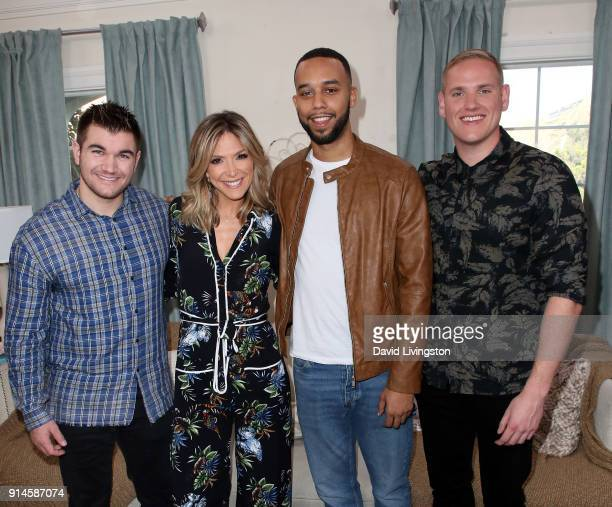 Actors Alek Skarlatos Anthony Sadler and Spencer Stone pose with host Debbie Matenopoulos at Hallmark's Home Family at Universal Studios Hollywood on...