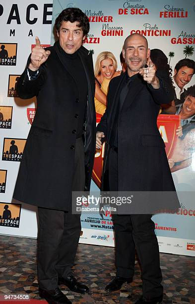 Actors Alessandro Gassman and Gianmarco Tognazzi attend the premiere of ''Natale A Beverly Hills'' at the Warner Moderno Cinema on December 17 2009...
