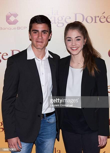 Actors Alex Alves Pereira and Alice Isaaz pose during the premiere of the movie La Cage Doree at Cinema Gaumont Marignan on April 15 2013 in Paris...