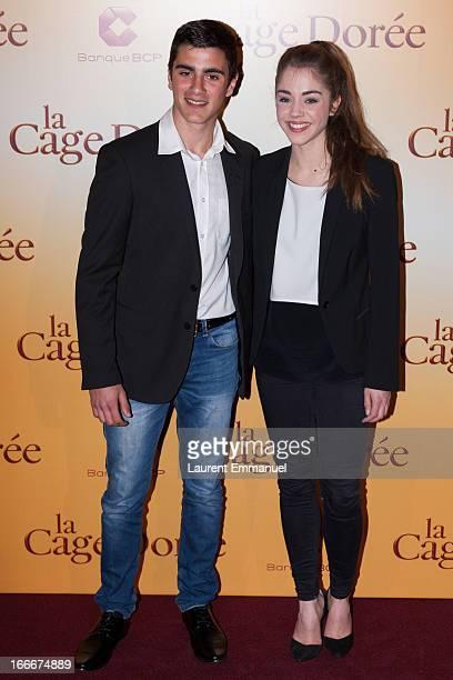 Actors Alex Alves Pereira and Alice Isaaz poses during the premiere of the movie La Cage Doree at Cinema Gaumont Marignan on April 15 2013 in Paris...