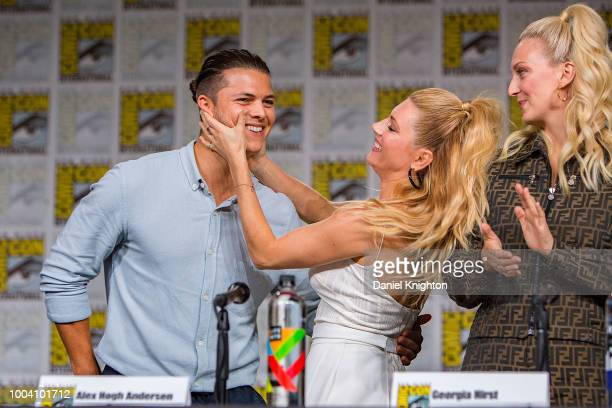 Actors Alex Hogh Andersen Katheryn Winnick and Georgia Hirst attend the Vikings panel at ComicCon International on July 20 2018 in San Diego...