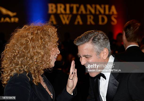 Actors Alex Kingston and George Clooney attend the 2013 BAFTA LA Jaguar Britannia Awards presented by BBC America at The Beverly Hilton Hotel on...