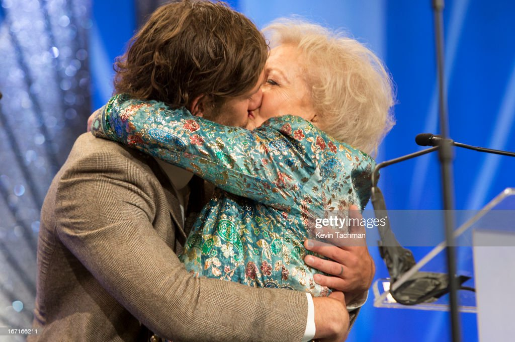Actors Alex Pettyfer (L) and Betty White on stage the 24th Annual GLAAD Media Awards presented by Ketel One and Wells Fargo at JW Marriott Los Angeles at L.A. LIVE on April 20, 2013 in Los Angeles, California.