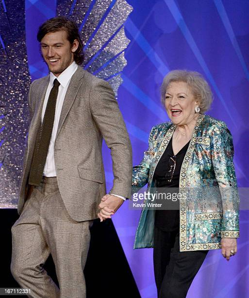 Actors Alex Pettyfer and Betty White speak onstage during the 24th Annual GLAAD Media Awards at JW Marriott Los Angeles at LA LIVE on April 20 2013...