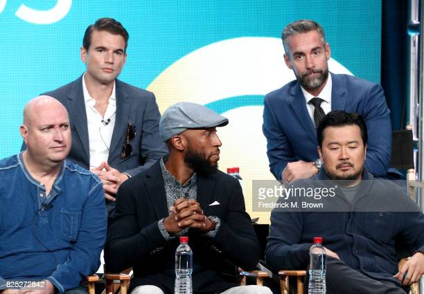 Actors Alex Russell Jay Harrington and executive producers Shawn Ryan Aaron Rahsaan Thomas Justin Lin of 'SWAT' speak onstage during the CBS portion...