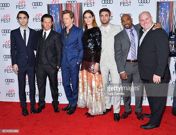 Actors Alex Wolff Mark Wahlberg Kevin Bacon Michelle Monaghan Themo Melikidze Michael Beach and James DuMont attend the premiere of 'Patriots Day' at...