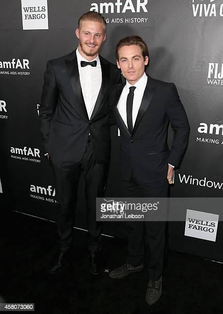 Actors Alexander Ludwig and Kevin Zegers attend amfAR LA Inspiration Gala honoring Tom Ford at Milk Studios on October 29 2014 in Hollywood California