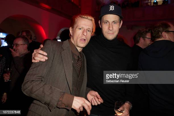 Actors Alexander Scheer and Marc Hosemann attend the Medienboard PreChristmas Party at Stadtbad Oderberger on December 12 2018 in Berlin Germany