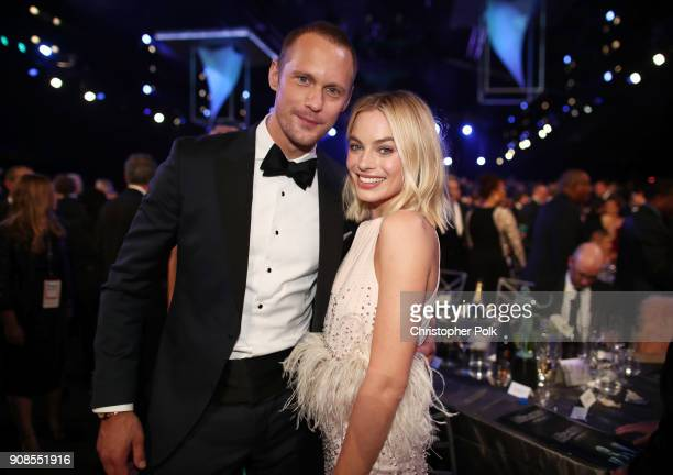 Actors Alexander Skarsgard and Margot Robbie attend the 24th Annual Screen Actors Guild Awards at The Shrine Auditorium on January 21 2018 in Los...
