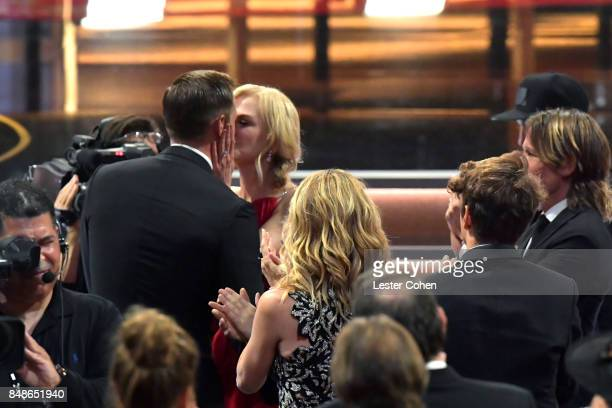 Actors Alexander Skarsgard and Nicole Kidman kiss during the 69th Annual Primetime Emmy Awards at Microsoft Theater on September 17 2017 in Los...