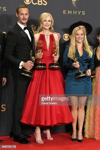 Actors Alexander Skarsgard Nicole Kidman and Reese Witherspoon pose in the press room during the 69th Annual Primetime Emmy Awards at Microsoft...