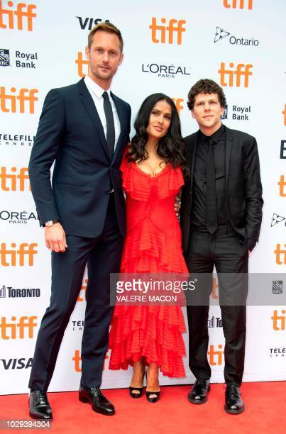 Actors Alexander Skarsgard Salma Hayek and Jesse Eisenberg attend the 'The Hummingbird Project' premiere during the Toronto International Film...