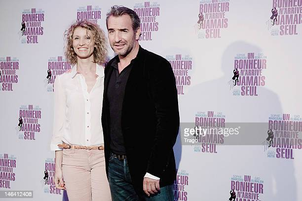 Actors Alexandra Lamy and Jean Dujardin attend 'Un Bonheur N'Arrive Jamais Seul' Premiere at Cinema Gaumont Marignan on June 15 2012 in Paris France