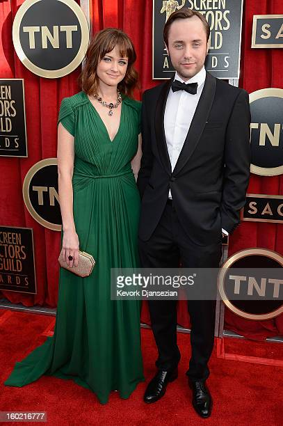 Actors Alexis Bledel and Vincent Kartheiser arrive at the 19th Annual Screen Actors Guild Awards held at The Shrine Auditorium on January 27 2013 in...