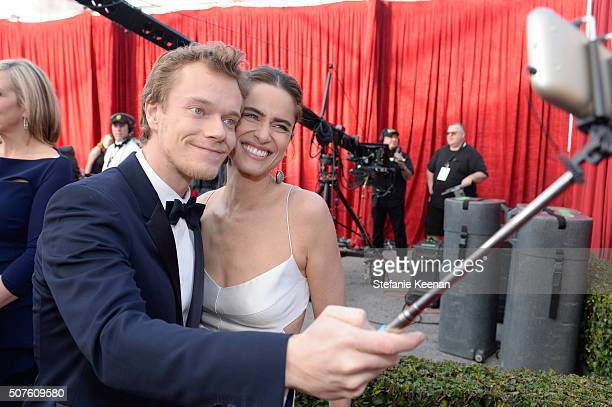 Actors Alfie Allen and Amanda Peet take a selfie on the red carpet at The 22nd Annual Screen Actors Guild Awards at The Shrine Auditorium on January...