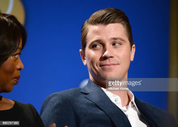 Actors Alfre Woodard and Garrett Hedlund speak during Moet Chandon Toasts The 75th Annual Golden Globe Awards Nominations at The Beverly Hilton Hotel...